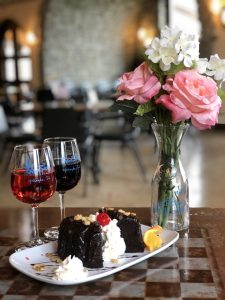 Chocolate Cake with Illinois Wine and Vase of Flowers